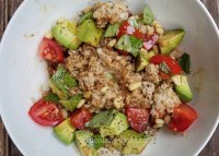 Vegan oatmeal with avocado and tomatoes