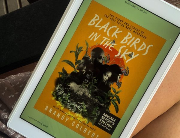 a photo of Black Birds in the Sky in my Kindle Fire resting on my leg