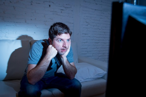 Man with eyes glued to TV