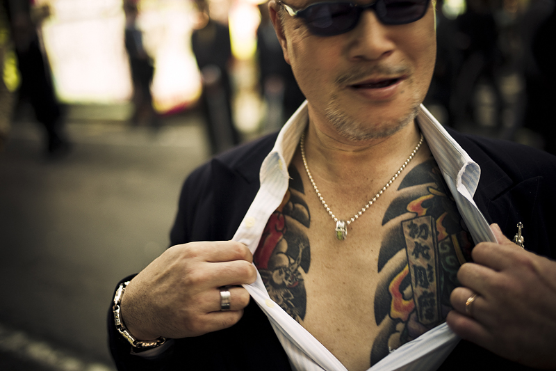 Yakuza street fighter aggressively showing off his tattoo in Kabukicho, Shinjuku, Tokyo - 2010