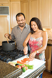 Man and a woman cooking together