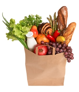 Photo of a paper grocery bag filled with fruits vegetables grains and dairy products - La diabetes Tipos y prevención de enfermedad