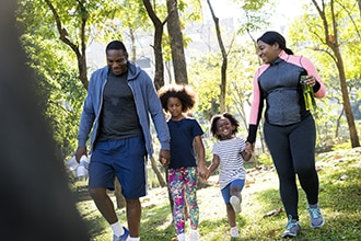 Family walking together outside.