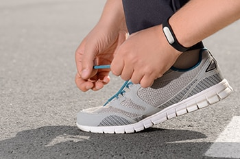 Fitness tracker shown on a person's wrist.