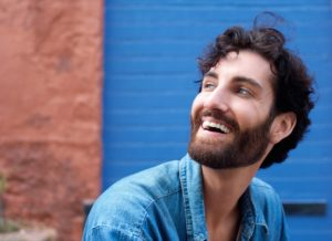 Attractive man with beard laughing