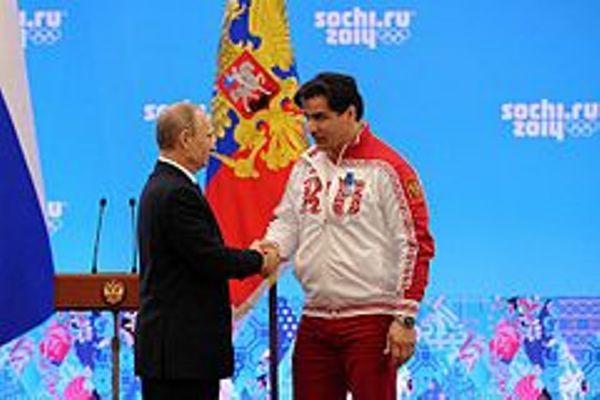 Vladimir Putin con Albert Demchenko 24 en febrero del 2014