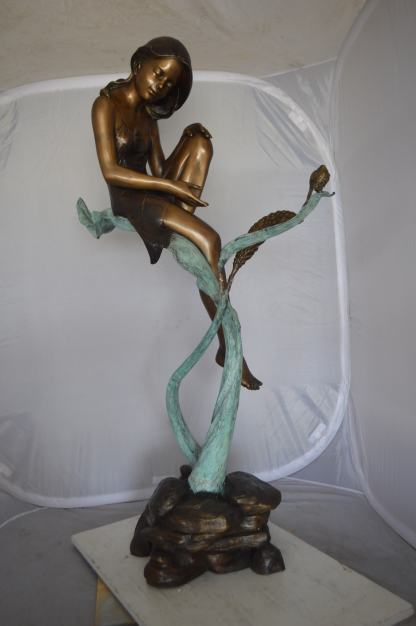 "Beautiful Young Girl Sitting on a Tree Bronze Statue -  35""L x 50""W x 55""H."