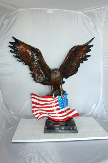 """Eagle with American Flag Bronze Statue -  Size: 32""""L x 14""""W x 35""""H."""