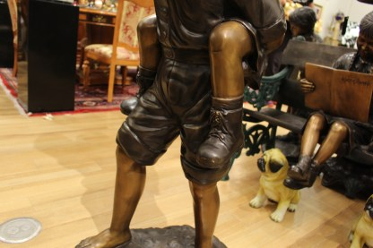"Boy Giving Girl Piggyback Ride Bronze Statue -  Size: 23""L x 16""W x 46""H."