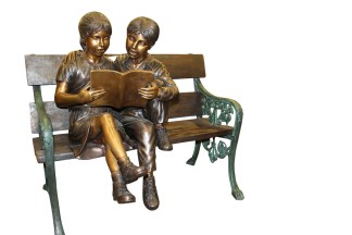 "Kids Reading a Book on a Bench Bronze Statue -  Size: 23""L x 38""W x 37""H."