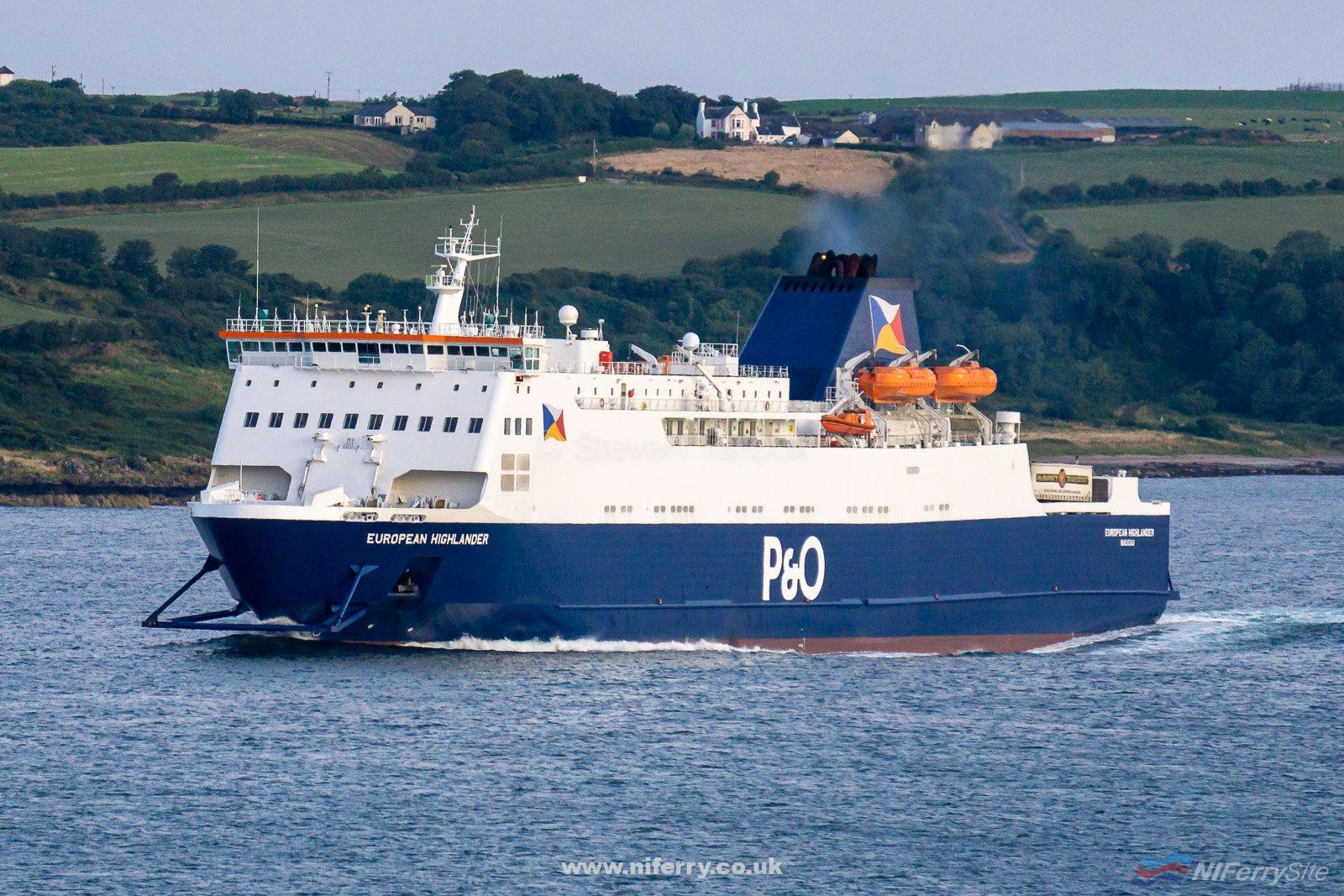 P&O Ferries EUROPEAN HIGHLANDER makes her way past Loch Ryan Port towards Cairnryan on her 04:00 sailing from Larne, 03.08.19. Copyright © Steven Tarbox.