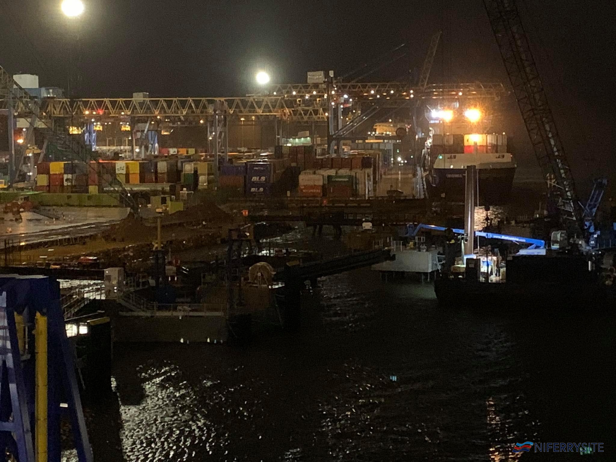 Work continues even in the dark on the upgrade of the berth at Belfast VT2. Copyright © David Faerder.