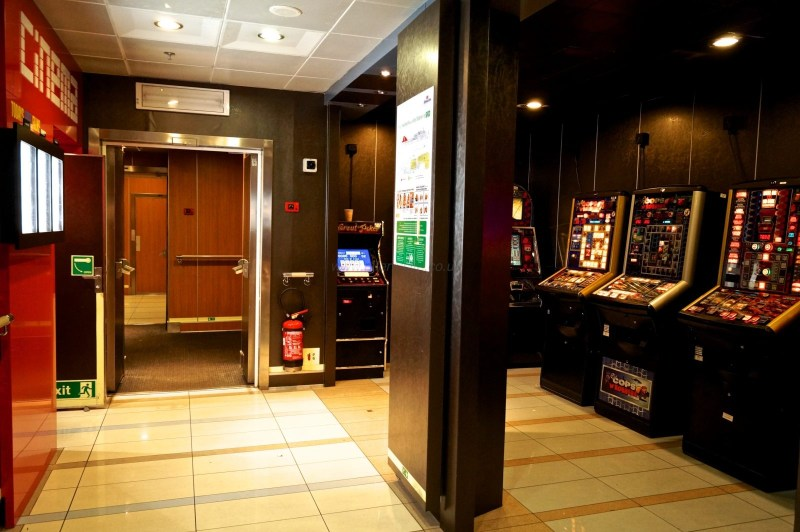 A view of the slot machines adjacent to the arcade machines in Teen Town and the exterior of the cinema. The cinema entrance is to the left. © NIFerrySite
