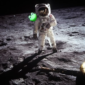 Ever vigilant frog on astronauts shoulder