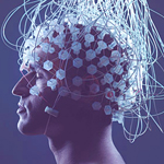 Image of Man's head covered in electrodes