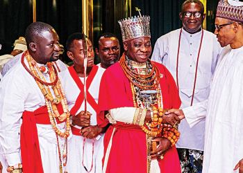 Olu of Warri, Ogiame Ikenwoli and President Muhammadu Buhari flanked by Itsekiri chiefs
