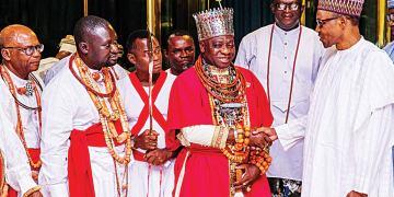 Olu of Warri, Ogiame Ikenwoli and President Muhammadu Buhari flanked by Itsekiri chiefs