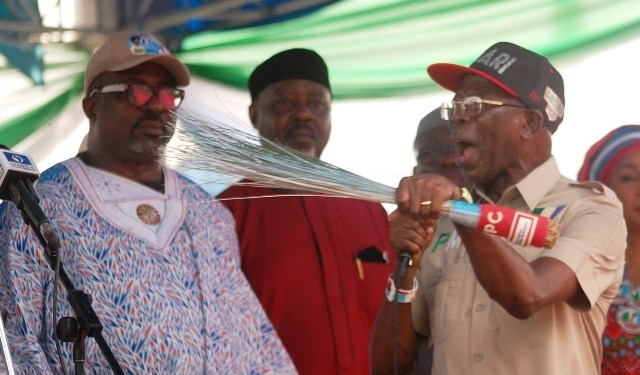 APC National Chairman, Adams Oshiomhole speaking at APC rally in Warri
