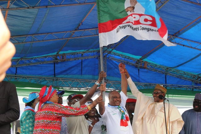 President Buhari presenting party's flag to Chief Great Ogboru APC rally in Delta