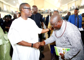 Delta State Governor, Senator Dr. Ifeanyi Okowa(left) in a warm handshake with Bashorun Askia Ogieh during his (Ogieh's) Thanksgiving Mass at St. Mathias Catholic church, Uzere.
