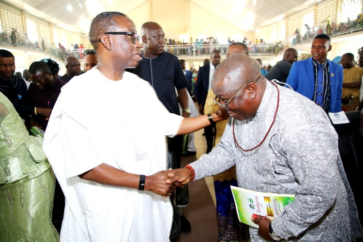 Delta State Governor, Senator Dr. Ifeanyi Okowa(left) in a warm handshake with Bashorun Askia Ogieh during his (Ogieh's) Thanksgiving Mass at St. Mathias Catholic church, Uzere.