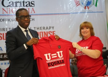 Governor, Senator Ifeanyi Okowa (left), and the Deputy Chief of Mission of the United State Centre for Disease Control, Kathleen FitzGibbon, at the official Launch of the Delta State Anti-retroviral Therapy Surge Response in Asaba. Thursday 9/1/20. PIX: BRIPIN ENARUSAI/ SAMUEL JIBUNOR