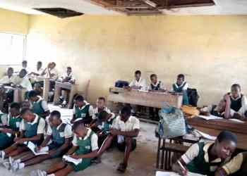 Students of Ogbe-Udu Secondary learning on bare floors in Delta State