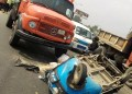 Scene of the accident where the woman and her daughter was crushed by police van chasing suspected yahoo boys