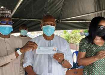 Olorogun Otega Emerhor (on white) and his wife, Chief (Mrs) Rita Emerhor being presented with their temporary APC membership cards after revalidating their APC membership at his Evwreni country-home in Delta State on Sunday by the Secretary of the Delta APC Registration/revalidation committee.