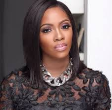 See how Tiwa Savage reacted as fan tattoos her name on chest