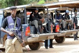 Nigeria police officers on police patrol vans