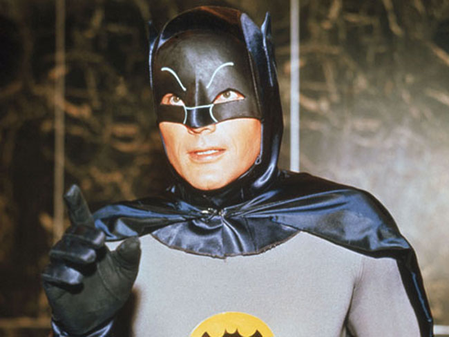 Adam West's Batman with one finger raised didactically.