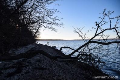 Angler bei Sonnenuntergang