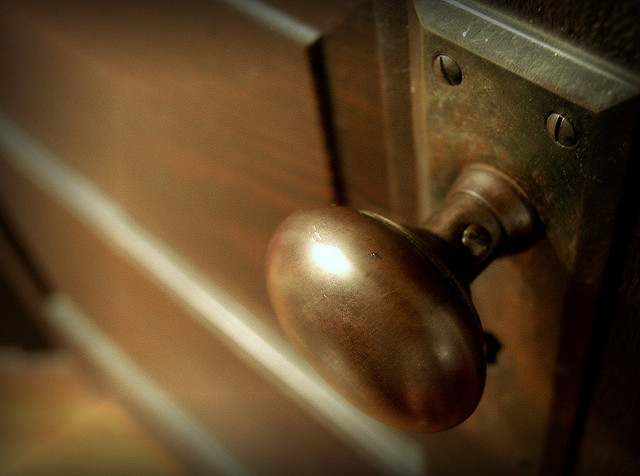 Close up of a vintage door and doorknob.
