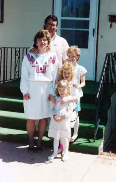 Lori with her husband and daughters, celebrating Easter.