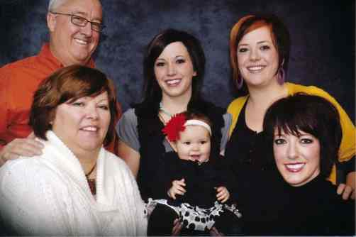 Lori with her husband, daughters, and granddaughter.