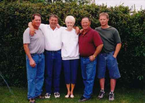 Sharon, Jerry DeMoe's widow, surrounded by her nephews: Doug, Dean, Brian, and Jamie.