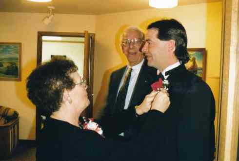 Gail DeMoe adjusts Dean's boutonniere prior to his wedding.