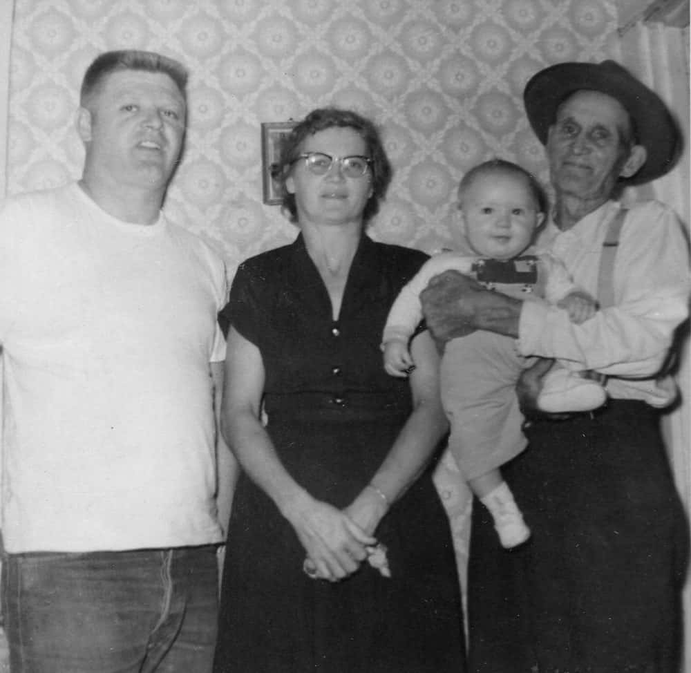 Galen DeMoe (left) with his parents, Wanda and James DeMoe (holding Galen's oldest son, Brian).