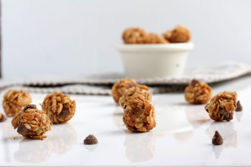 Side view of Mini Chocolate Chip and Oat Energy Balls - www.nikkisplate.com