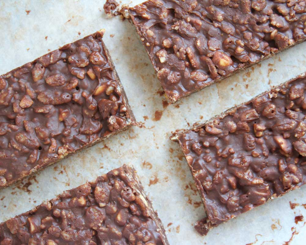 4 Ingredient Chocolate Vegan Crunch Bars - Photo looking down on to chocolate bars. Quick and easy snack bars (or dessert) are gluten free, vegan, dairy free - www.nikkisplate.com