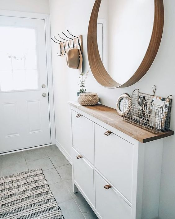 13 Ikea Hacks You Haven't Seen Yet; unique and amazing ways to transform your Ikea purchases into fabulous home decor. || white Shoe cabinet hack - Nikki's Plate www.nikkisplate.com