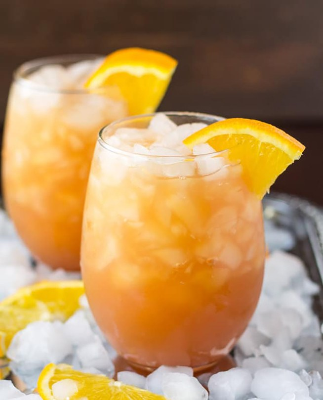 9 Fun Non-Alcoholic Mocktails - this orange, cranberry, and apple mocktail is a perfect combination of summer flavors.