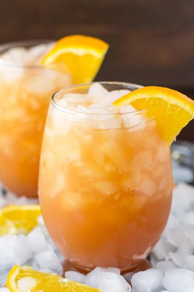 9 Fun Non-Alcoholic Mocktails you can enjoy this summer and not regret the next day! - Orange, Cranberry and apple cocktail
