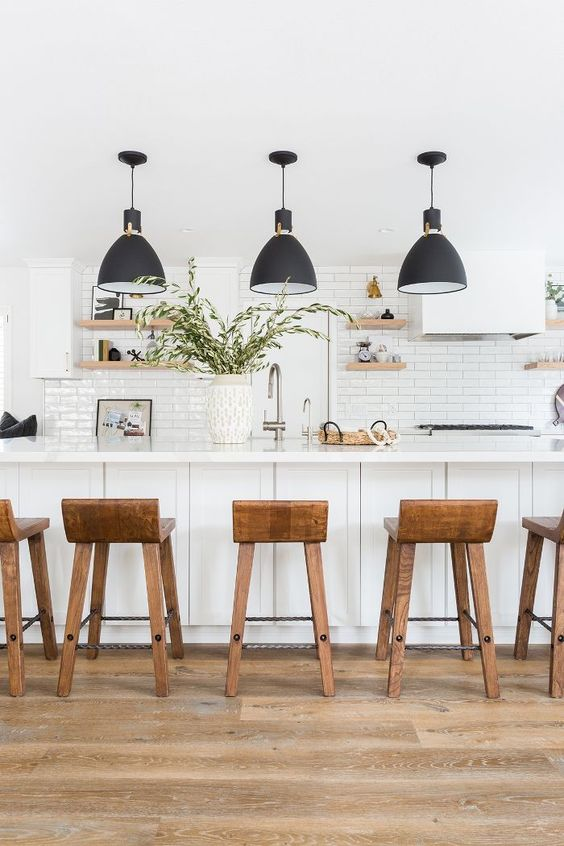 White Kitchen Designs You Haven't Seen Yet! Beautiful white kitchen inspiration for your remodel. Marble Countertop, wood bar stools, island light, island, bright white #whitekitchen #modern