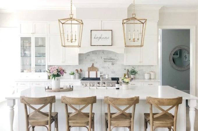 White Kitchen Designs You Haven't Seen Yet! Beautiful white kitchen inspiration for your remodel. Marble Countertop, black pendant light, island, bright white #whitekitchen #modern