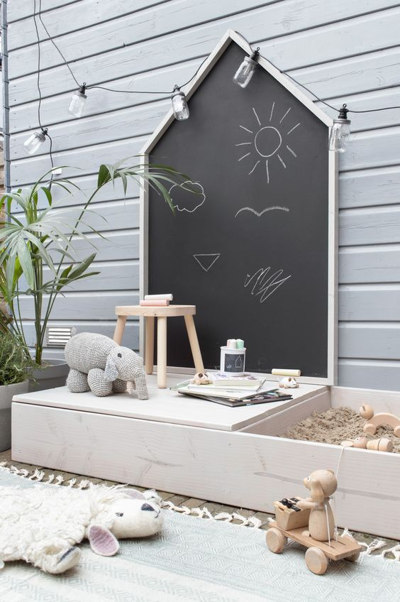 15 Deck Must Haves for Summer Entertaining; kids play area on deck, chalkboard, sand pit