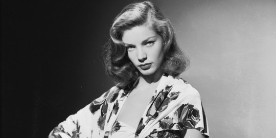 circa 1945: American screen star Lauren Bacall wearing a summer suit in a bold floral print. (Photo via John Kobal Foundation/Getty Images)