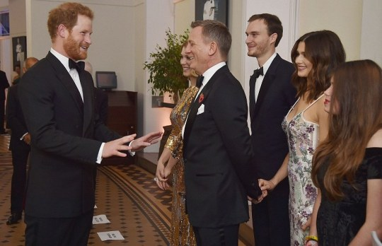 2DD0993B00000578-3290524-Prince_Harry_meets_with_Daniel_Craig_who_is_joined_by_his_wife_R-a-140_1445902195565