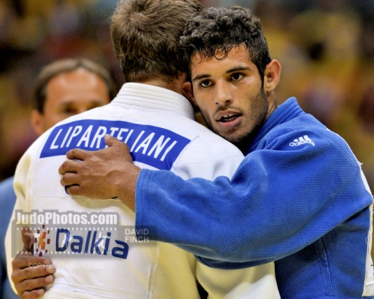 RIO DE JANEIRO, BRAZIL - AUGUST 29: Asley Gonzalez CUB consoles Varlam Liparteliani GEO after defeating him for the u90kg gold medal at the Rio World Judo Championships, on day 4, Thursday, August 29, 2013 at the Gympasium Maracanazinho, Rio de Janeiro, Brazil. (Copyright: Photo by David Finch)